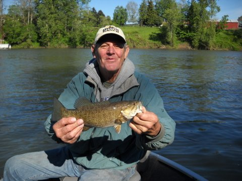 Angler holding a good-sized smallmouth bass caught in the Clackamas County section of the Willamette River.