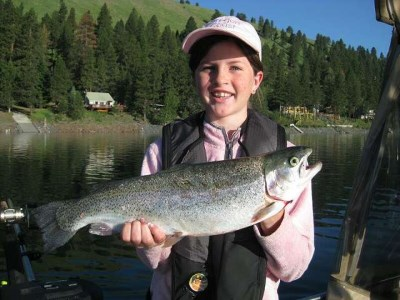girls holds up a large rainbow trout caught at wallowa lake