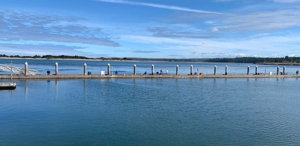 A long dock in Bandon is lined with recreational crabbers.