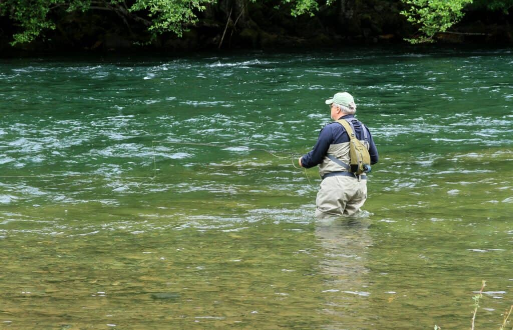 An angler fly fishing on the North Umpqua River