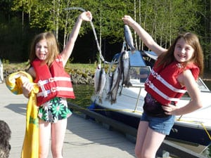 kids hold up a stringer of trout caught at detroit lake