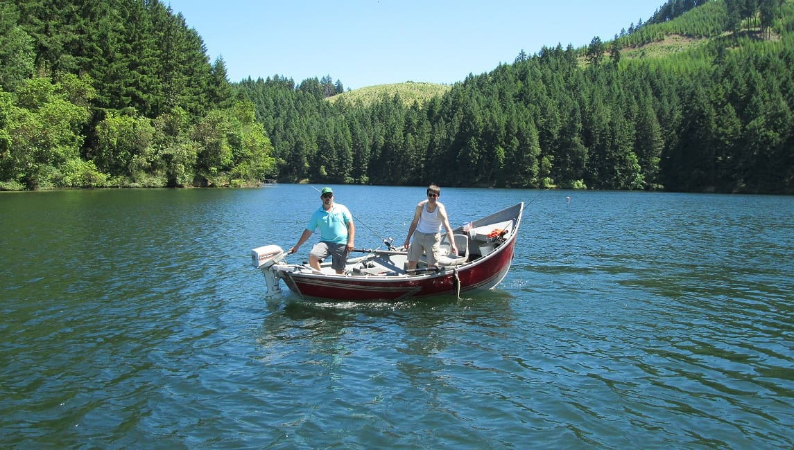 Two people fishing in a boat at Cooper Creek Reservoir in Southwestern Oregon.