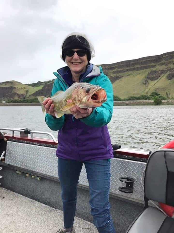 woman holding a columbia river walleye