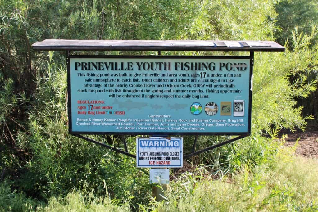 Photo of the sign for prineville youth fishing pond