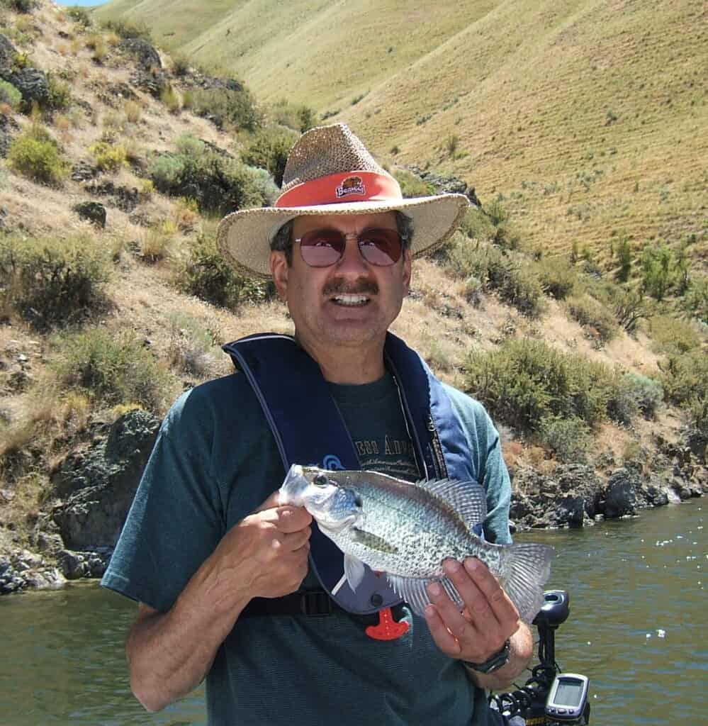 An average crappie fishing from a boat at Brownlee Reservoir on the Oregon Idaho border.