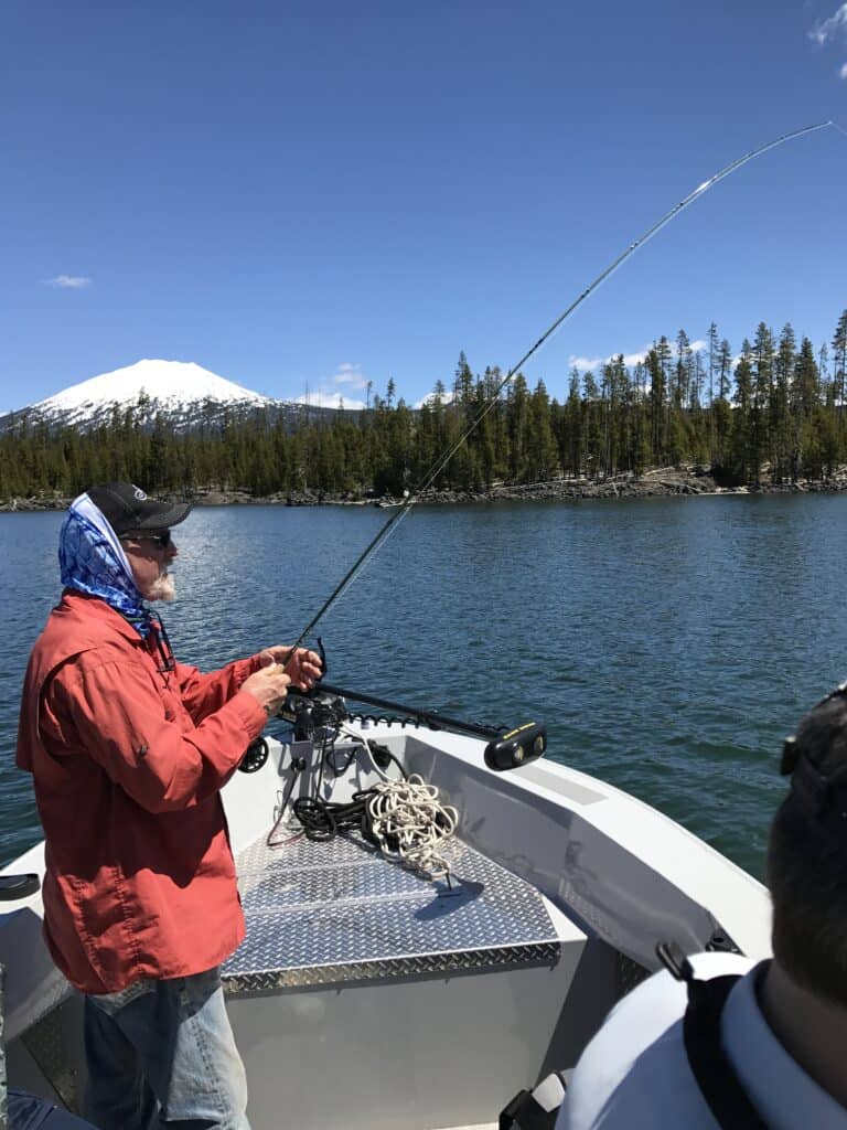 fly fishing for trout at lava lake in central oregon
