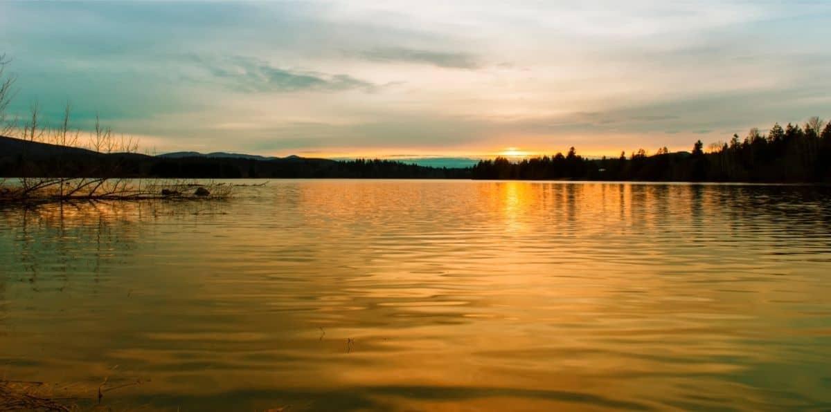 The sun setting over Alder Lake in Western Washington.