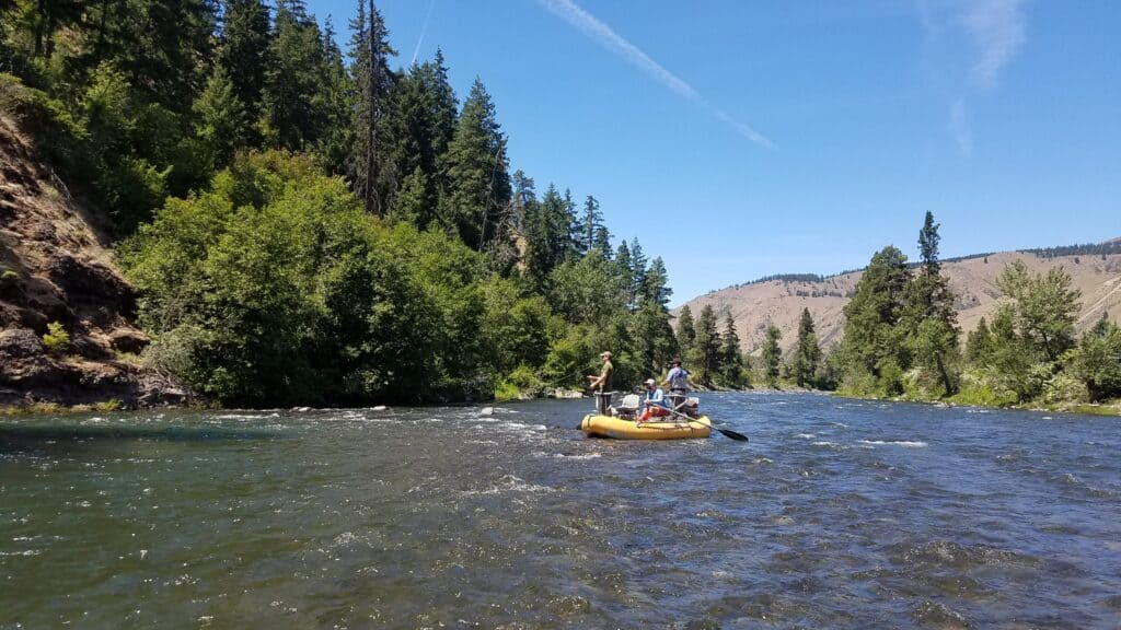 This photo shows fly anglers fishing from a raft on the Naches River in central Washington.