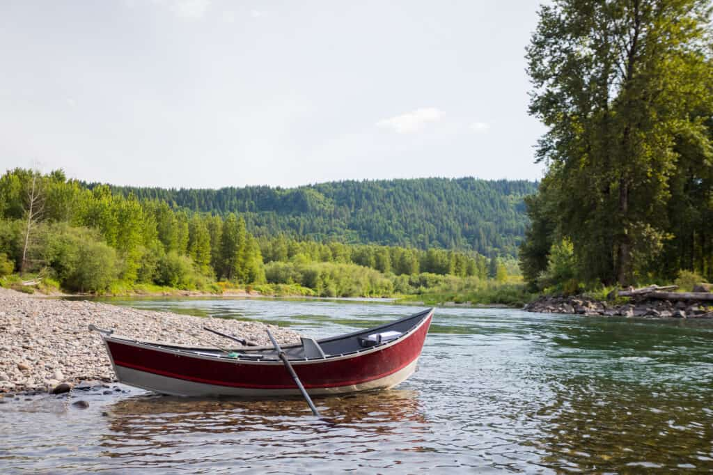 Drift boat sits along the banks of the McKenzie River.