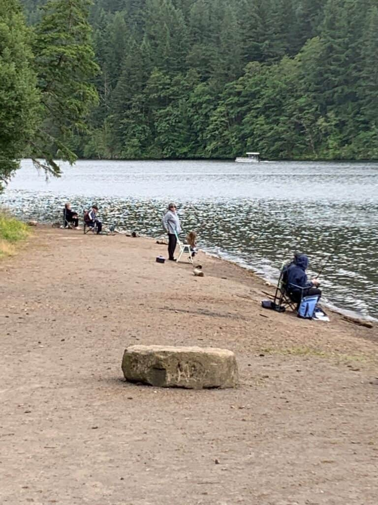 Anglers fish for trout from the bank at North Fork Reservoir.