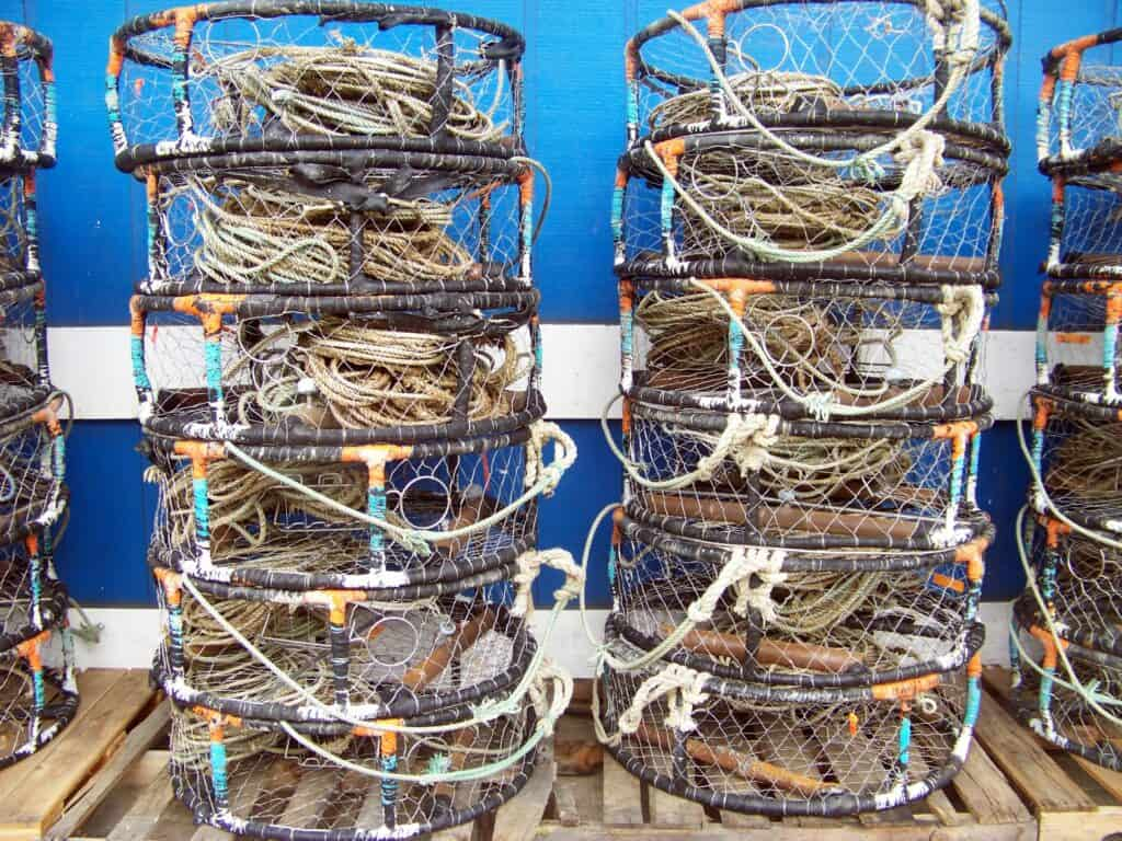 Crab pots are stacked at the docks of Yaquina Bay in Newport, Oregon.