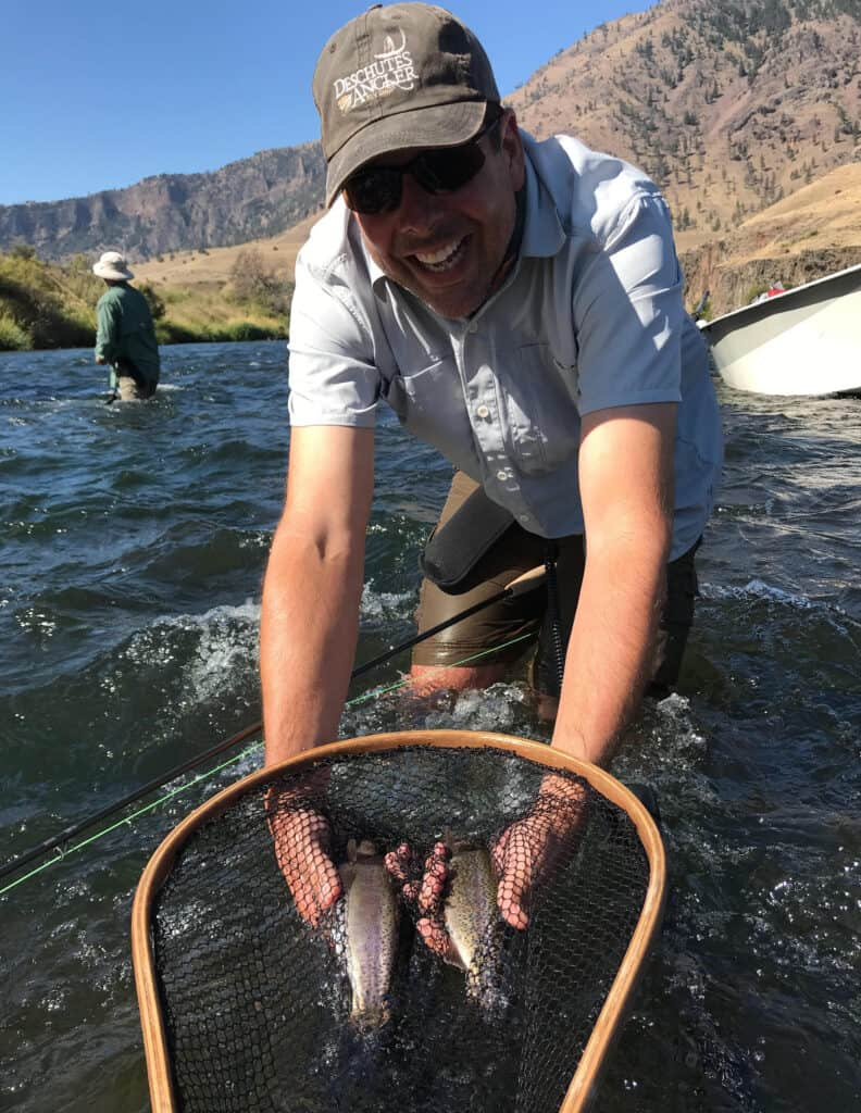 Two trout in a net ready for release back into the deschutes river