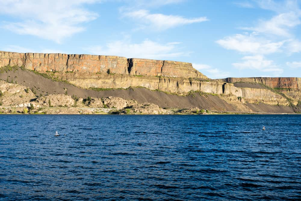 cliffs rise above banks lake, an excellent fishing reservoir in central washington