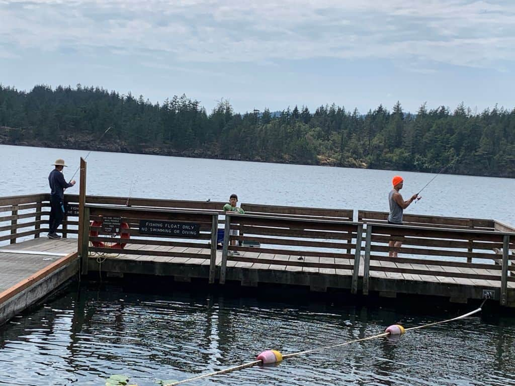 Anglers fishing for trout and other fish from the dock at Cascade Lake