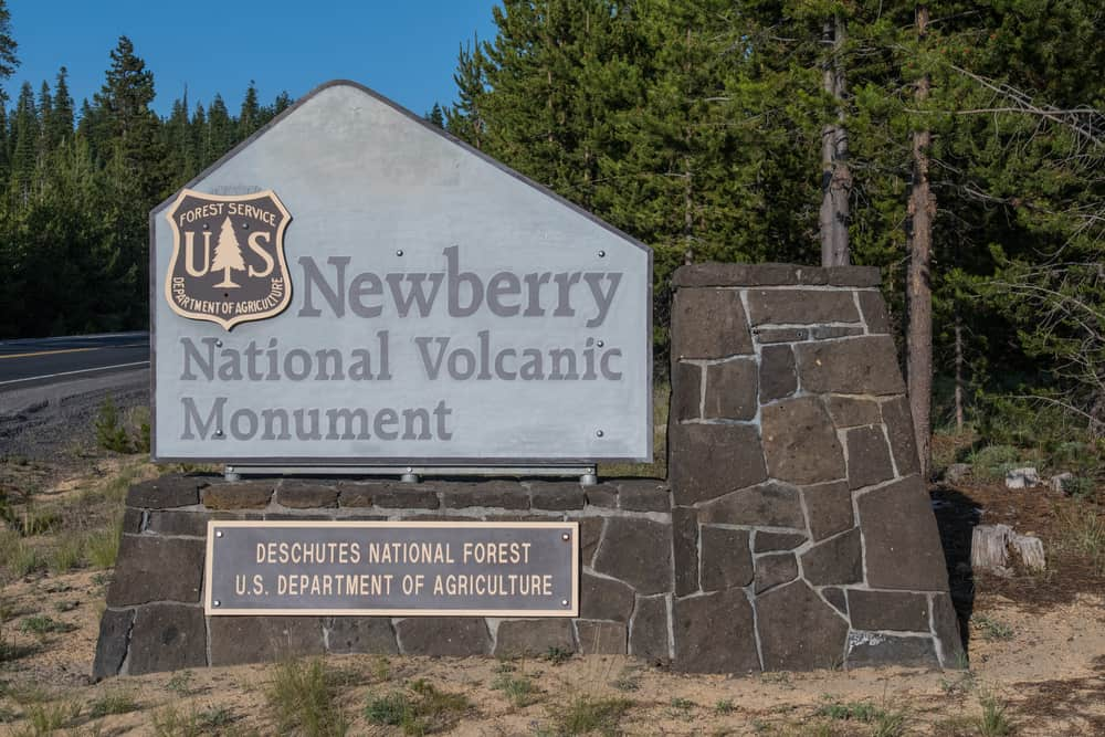 sign for the newberry national volcanic monument, location of paulina lake fishing