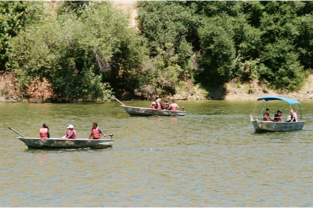 Three boats with electric motors cruise by on Lake Chabot, a Bay Area lake known for fishing.