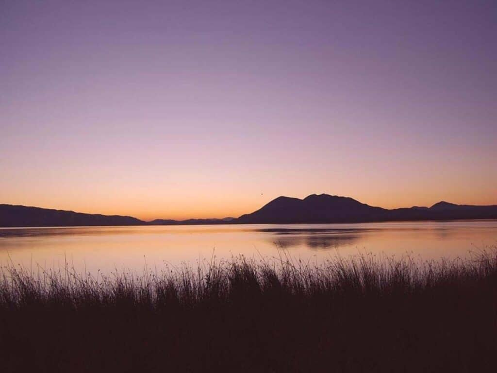 Sunset offers up purple and orange hues reflecting on the surface of Clear Lake.