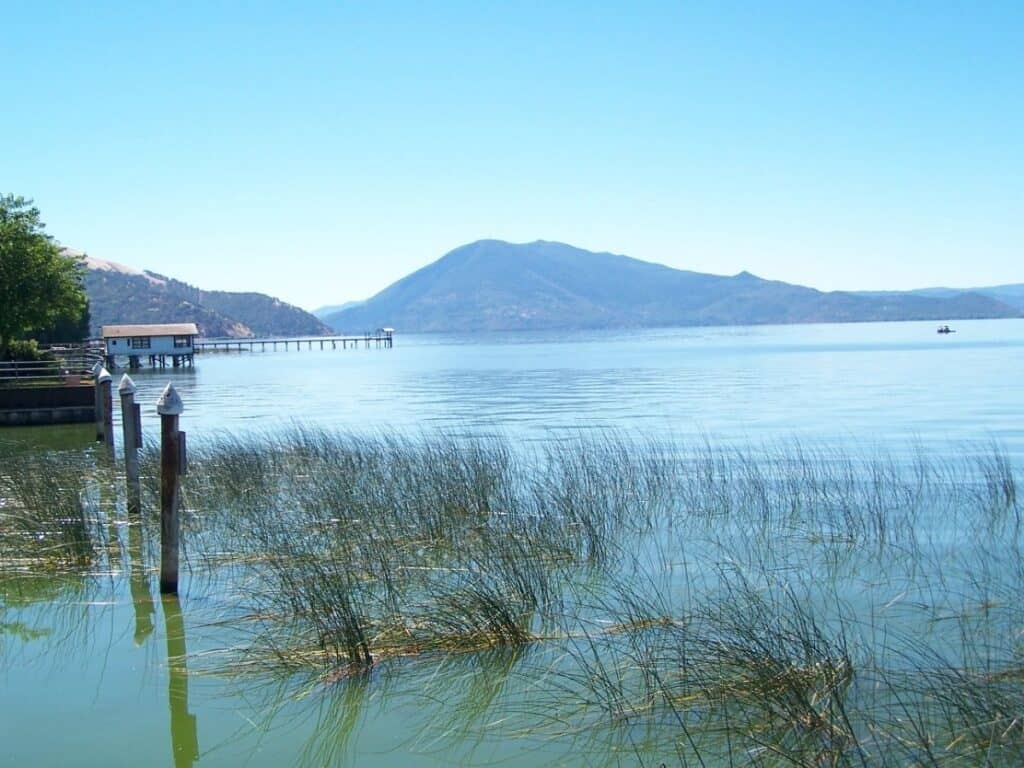 A fishing boat and fishing pier on Clear Lake, California.